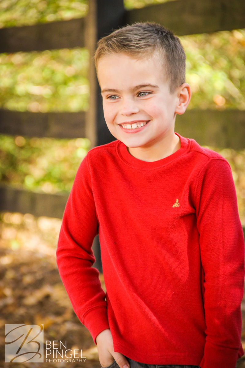 Jack smiling in fall child portrait
